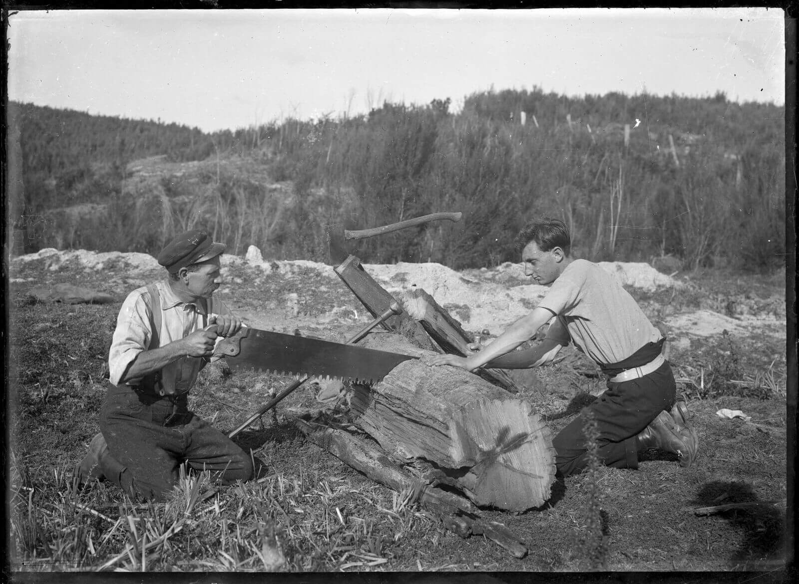 Image of two men sawing a big piece of timber, from the Bullswool Farm Heritage Working Farm Tools Museum